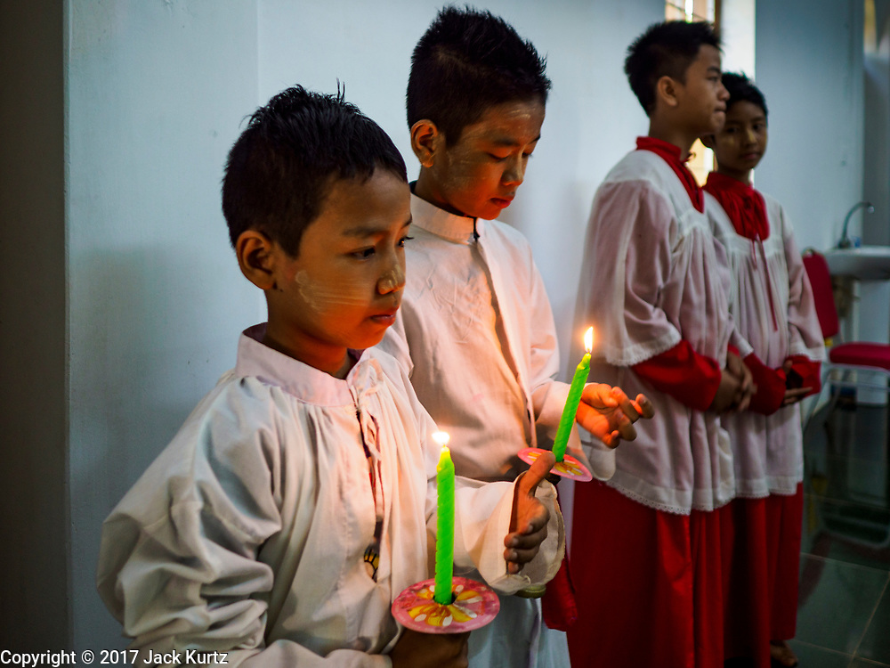 19 NOVEMBER 2017 - HWAMBI, YANGON REGION, MYANMAR:  Altar boys prepare to assist in mass at Sacred Heart's Catholic Church in Hwambi, about 90 minutes north of Yangon. Catholics in Myanmar are preparing for the visit of Pope Francis. He is coming to the Buddhist majority country November 27-30. There about 500,000 Catholics in Myanmar, about 1% of the population. Catholicism was originally brought to what is now Myanmar more than 500 years ago by Portuguese missionaries and traders.   PHOTO BY JACK KURTZ