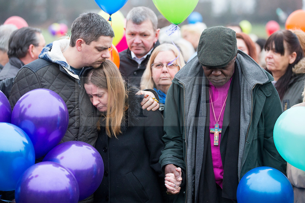 © Licensed to London News Pictures. 16/01/2017. York UK.Picture shows Katie Rough's parents Paul Rough & Alison Rough (left) with the Arch Bishop of York, the couple where joined by hundreds of people in Westfield Park in York this afternoon to release balloons on what would have been Katie's 8th birthday. Katie died last week after being found with significant cuts to her neck & chest.  Photo credit: Andrew McCaren/LNP