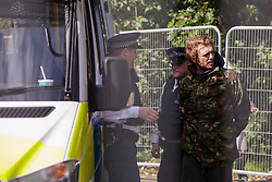 Police officers arrest a housing activist following his eviction by bailiffs from the Sweets Way housing estate on 23rd September 2015 in London, United Kingdom. A group of housing activists calling for better social housing provision in London had occupied some of the properties on the 142-home estate in Whetstone, in some cases refurbishing properties intentionally destroyed by the legal owners following eviction of the original residents, in order to try to prevent the eviction of the last resident on the estate and the planned demolition and redevelopment of the entire estate by Barnet Council and Annington Property Ltd.