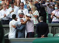 Lawn Tennis - 2021 All England Championships - Men's Final Sunday - Wimbledon - Novak Djokovic  v Matteo Berrettini on Centre Court<br /> <br /> Novak Djokovic climbs up into the players box to see his coaches<br /> <br /> Credit : COLORSPORT / Andrew Cowie