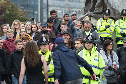 © Licensed to London News Pictures . 03/10/2015 . Manchester , UK . Crowds gather to watch as protesters against the Conservative government's policies hold a non-stop rave in Piccadilly Gardens in Manchester City Centre ahead of the Conservative Party's annual conference . Photo credit: Joel Goodman/LNP
