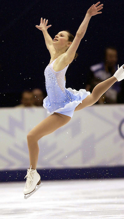 Sasha Cohen of the USA stakes her way to a third place finish in the womens short program Tuesday Feb. 19, 2002 At the 2002 Winter Olympic Games in Salt Lake City, Utah. Photo by August Miller.