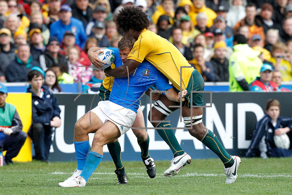 Auckland 11/09/2011 North Harbour Stadium <br /> Rugby World Cup : Australia vs Italy<br /> Tommaso Benvenuti tackled by Radike Samo