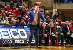 Dec 1, 2018; Morgantown, WV, USA; Youngstown State Penguins head coach Jerrod Calhoun yells from the bench during the first half against the West Virginia Mountaineers at WVU Coliseum. Mandatory Credit: Ben Queen-USA TODAY Sports