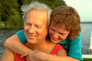 Romantic couple age 55 embracing in motor boat on Sand Lake.  Cumberland  Wisconsin USA