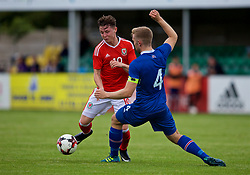 RHYL, WALES - Monday, September 4, 2017: Wales' Kieran Holsgrove and Iceland's Torfi T.Gunnarsson during an Under-19 international friendly match between Wales and Iceland at Belle Vue. (Pic by Paul Greenwood/Propaganda)