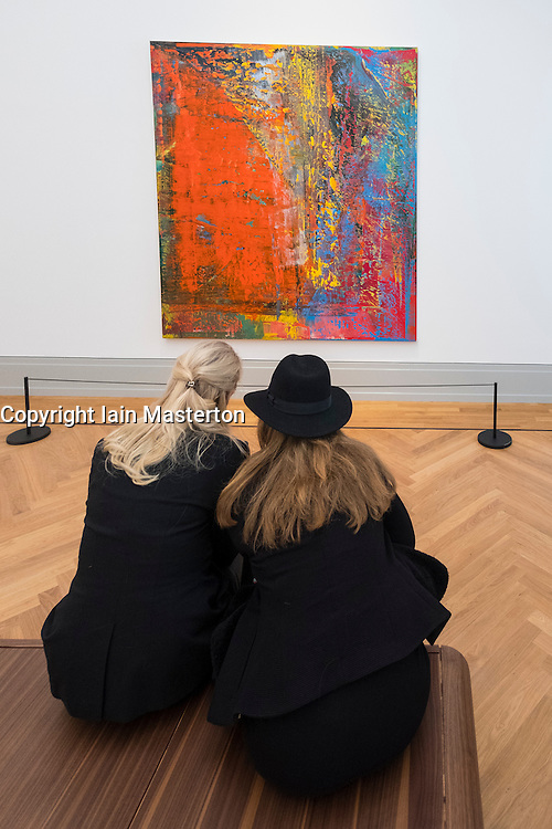 Visitors looking at painting A B Still by Gerhard Richter,  at new Museum Barberini in Potsdam Germany