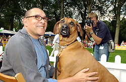 Fashion designer BRUCE OLDFIELD and his dog Babe at the Macmillan Cancer Relief Dog Day held at the Royal Hospital Chelsea South Grounds, London on 6th July 2004.
