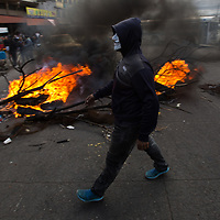 Burning barricades on the street in Comayagüela during protests against electoral fraud