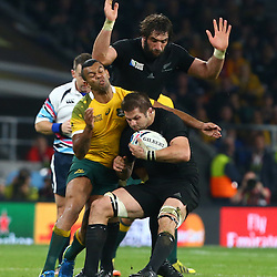 LONDON, ENGLAND - OCTOBER 31: Kurtley Beale of Australia tackling Richie McCaw (captain) of New Zealand during the Rugby World Cup Final match between New Zealand vs Australia Final, Twickenham, London on October 31, 2015 in London, England. (Photo by Steve Haag)