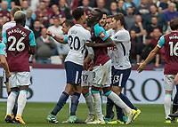 Football - 2017 / 2018 Premier League - West Ham United vs Tottenham Hotspur<br /> <br /> Dele Alli (Tottenham FC)  and Cheikhou Kouyate (West Ham United) square up to each other at the London Stadium<br /> <br /> COLORSPORT/DANIEL BEARHAM