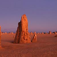 Australia, Western Australia, Nambung National Park, Early morning sun lights limestone pinnacles in desert near town of Cervantes