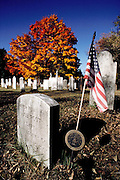 Tombstone of a French-Indian war soldier with Fall foliage in Farmington, Connecticut, New England, USA.