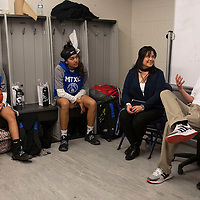 Laguna-Acoma Hawks basketball coaches head coach Daniel Garcia, right, and assistant coach Monika Sanchez talk pregame strategy with the girls varsity team before their playoff game Friday night in Casa Blanca.