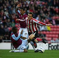 Photo: Andrew Unwin.<br />Sunderland v West Ham United. The Barclays Premiership.<br />01/10/2005.<br />Sunderland's Dean Whitehead (R) is fouled by West Ham's Danny Gabbidon (L).