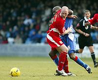 Photo: Chris Ratcliffe.<br />Gillingham v Bristol City. Coca Cola League 1. 26/12/2005.<br />Steven Brooker (R) of Bristol City tussles with Ian Cox of Gillingham.