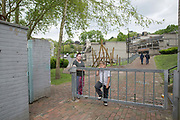 A family on Central Hill Estate on 17th May 2016 in South London, United Kingdom. Central Hill is a low-rise estate of more than 450 homes in Crystal Palace in South London and has been recommended for demolition under Lambeth Council estate regeneration plan. The housing scheme, builtbetween 1966 and1974, was designed by Rosemary Stjernstedt under Lambeth Council's director of architecture,Ted Hollamby.