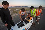 Sebastiaan Bowier wordt uit de VeloX2 geholpen na zijn race op de derde racedag van het WHPSC. In de buurt van Battle Mountain, Nevada, strijden van 10 tot en met 15 september 2012 verschillende teams om het wereldrecord fietsen tijdens de World Human Powered Speed Challenge. Het huidige record is 133 km/h.<br /> <br /> Sebastiaan Bowier is helped out of the VeloX2 after his race on the third day of the WHPSC. Near Battle Mountain, Nevada, several teams are trying to set a new world record cycling at the World Human Powered Speed Challenge from Sept. 10th till Sept. 15th. The current record is 133 km/h.