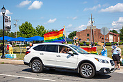 A passenger in a car holds a pride flag through the sunroof as during a Pride Rally in Milton, Pennsylvania on August 8, 2020. The I Am Alliance organized the event to show support for the LGBTQ community. (Photo by Paul Weaver)