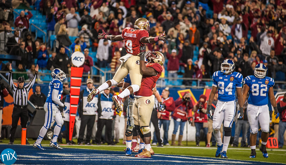 Florida State running back Karlos Williams (9) celebrates with Cameron Erving after scoring a touchdown against Duke during the ACC Championship game at Bank of America Stadium in Charlotte Saturday night. Florida State won the game 45-7.