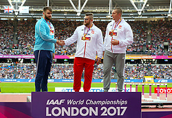Poland's Pawel Fajdek (centre) celebrates winning gold, Russia's Valeriy Pronkin with silver (left) and Poland's  Valeriy Pronkin with Bronze on the podium after the Men's Hammer Throw during day nine of the 2017 IAAF World Championships at the London Stadium. PRESS ASSOCIATION Photo. Picture date: Saturday August 12, 2017. See PA story ATHLETICS World. Photo credit should read: Jonathan Brady/PA Wire. RESTRICTIONS: Editorial use only. No transmission of sound or moving images and no video simulation.