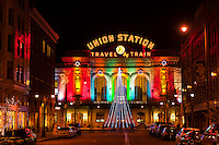 Looking down 17th Street in Downtown Denver to Union Station, illuminated for the Holiday season, Denver, Colorado USA