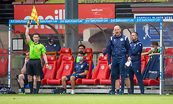 31JUL21 Queen of the South's Manager Allan Johnston reacts to Partick Thistle's Brian Graham's tackle. Partick Thistle 3 v 2 Queen of the South. First Scottish Championship game of the season.