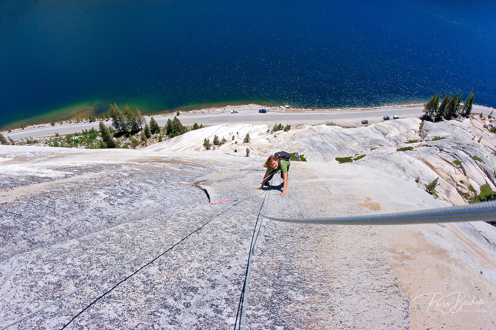 Climber on Stately Pleasure Dome above Tanaya Lake, Tuolumne Meadows area, Yosemite National Park, California