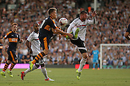 caption correction : Matt Ritchie of Newcastle United and Ryan Tunnicliffe of Fulham both leap for the ball. Skybet EFL championship match, Fulham v Newcastle Utd at Craven Cottage in Fulham, London on Friday 5th August 2016.<br /> pic by John Patrick Fletcher, Andrew Orchard sports photography.