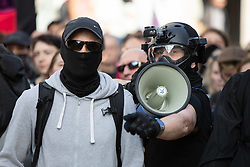 © Licensed to London News Pictures. 13/10/2018. London, UK. Counter demonstrators from Stand Up To Racism and Unite Against Fascism demonstrate against the Democratic Football Lads Alliance (DFLA). The DFLA are holding a demonstration in central London. Strict conditions have been imposed upon the march to prevent 'serious disorder' following previous demonstrations. Photo credit : Tom Nicholson/LNP