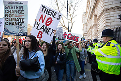 © Licensed to London News Pictures. 15/02/2019. London, UK. Young people demonstrate against climate change outside Downing Street, as part of the group 'Youth Strike 4 Climate'. Many children across the UK today walked out of school as part of a global campaign calling for action over climate change. Photo credit : Tom Nicholson/LNP