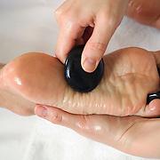 Woman getting hot la stone therapy
