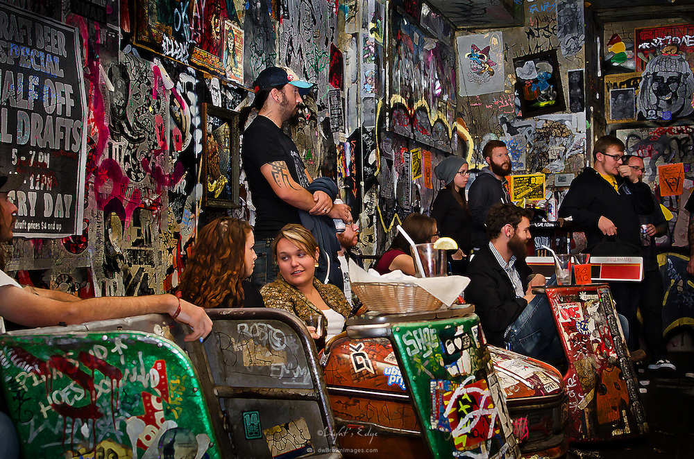 Upstairs, inside of Tattooed Mom, The Philadelphia Beard & Mustache Club members listen to opinions prior to a vote.