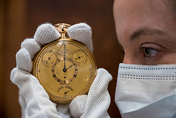 © Licensed to London News Pictures. 09/07/2020. LONDON, UK.  A staff member presents King George III's Tourbillon Watch at a photocall at Sotheby's, New Bond Street.  The cutting edge gold watch was sold by watchmaker Abraham-Louis Breguet to the King of England during the Napoleonic Wars.  With an estimate of GBP700,000 - 1 million, it will be sold at auction in London on 14 July.  Photo credit: Stephen Chung/LNP