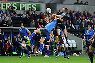 Leinster's Rob Kearney (l) jumps for a high ball with Dan Biggar of the Ospreys. Heineken cup rugby, pool 1 match, Ospreys v Leinster rugby at the Liberty stadium in Swansea on Sat 12th October 2013 pic by Andrew Orchard, Andrew Orchard sports photography,