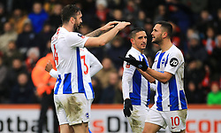 Brighton & Hove Albion's Florin Andone (right) celebrates scoring his side's third goal of the game with team-mate Shane Duffy during the Emirates FA Cup, third round match at the Vitality Stadium, Bournemouth.