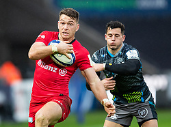 Rhys Carre of Saracens claims the high ball from Shaun Venter of Ospreys<br /> <br /> Photographer Simon King/Replay Images<br /> <br /> European Rugby Champions Cup Round 5 - Ospreys v Saracens - Saturday 11th January 2020 - Liberty Stadium - Swansea<br /> <br /> World Copyright © Replay Images . All rights reserved. info@replayimages.co.uk - http://replayimages.co.uk