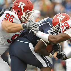Oct 31, 2009; East Hartford, CT, USA; Rutgers defensive tackle Charlie Noonan (96) and cornerback Zaire Kitchen (29) tackle Connecticut running back Jordan Todman (23) during first half Big East NCAA football action between Rutgers and Connecticut at Rentschler Field.