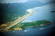 View through plane window of runway of international airport, Mahe, Seychelles