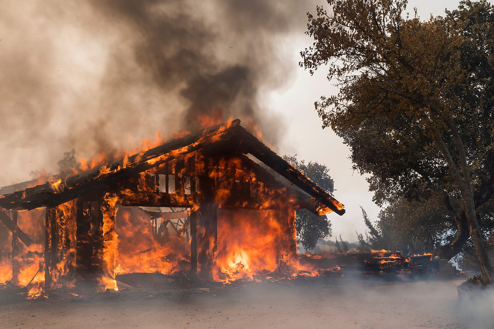 A house in the Sky Ranch community burns in the Carmel Fire in Cachagua, Calif. on Aug. 18, 2020.