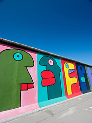 Murals painted on Berlin Wall at East Side Gallery in Berlin Germany