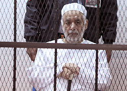 Former Libyan Prime Minister Baghdadi al-Mahmoudi (front) sits in a cage during his trial at a court in Tripoli, capital of Libya, on Jan. 14, 2013. The trial of former Prime Minister Baghdadi al-Mahmoudi started here on Monday. Mahmoudi, who served as the last prime minister in former leader Muammar Gaddafi's administration from 2006 to 2011, fled to Tunisia in September 2011 after the armed rebels seized the Libyan capital of Tripoli during the unrest,  January 14, 2013. Photo by Imago / i-Images...UK ONLY