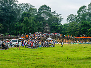 Monks and people gather at Angkor Thom to celebrate Water Festival, a Buddhist celebration in Cambodia. Angkor Wat Archeological Park, Siem Reap, Cambodia.