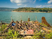 21 JANUARY 2016 - KHLONG PHAI, NAKHON RATCHASIMA, THAILAND: A derelict raft on the shore at Lam Takhong Dam in Nakhon Ratchasima province. The dam is only 30 percent of its capacity and farmers downstream have been told they can't draw irrigation water from the dam.  The drought gripping Thailand was not broken during the rainy season. Because of the Pacific El Nino weather pattern, the rainy season was lighter than usual and many communities in Thailand, especially in northeastern and central Thailand, are still in drought like conditions. Some communities, like Si Liam, in Buri Ram, are running out of water for domestic consumption and residents are traveling miles every day to get water or they buy to from water trucks that occasionally come to the community. The Thai government has told farmers that can't plant a second rice crop (Thai farmers usually get two rice crops a year from their paddies). The government is also considering diverting water from the Mekong and Salaween Rivers, on Thailand's borders to meet domestic needs but Thailand's downstream neighbors object to that because it could leave them short of water.     PHOTO BY JACK KURTZ