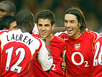 16/10/2004<br />FA Barclays Premiership - Arsenal v Aston Villa - HIghbury<br />Arsenal's Robert Pires (r) celebrates with team mates Francesc Fabregas (cen) and Lauren after scoring the 3rd goal.<br />Photo:Jed Leicester/BPI (back page images)