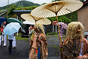 The Sarutahiko-no-kami. the role of these Kami are to guide the Mikoshi during the Summer Festival parade through the village of Kiso Mura. As one theory goes, it is said that these kami represents western people as they have big nose, big eyes, red and white faces, and blond hair. Sarutahiko-no-kami guides Mikoshi from the Yabuhara sanctuary, across the village and back to the sanctuary at the end of the festivities.
