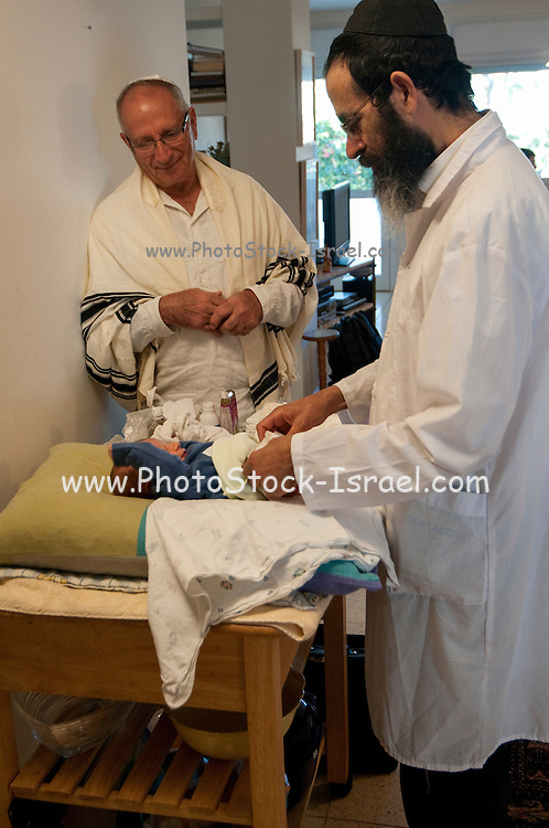 Circumcision - Brith Mila Ceremony The mohel at work