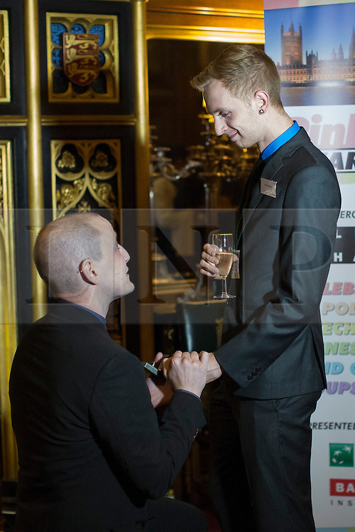 © licensed to London News Pictures. London, UK 23/10/2013. Joseph Patrick McCormick (left) proposing to James Hanson at Speakers House, Palace of Westminster, London during The Pink News Awards on Wednesday, 23 October 2013. Mr Hanson said yes. Photo credit: Tolga Akmen/LNP