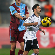 Besiktas's Simao SABROSA (R) and Trabzonspor's Ceyhun GULSELAM (L) during their Turkey Cup Group B matchday 5 soccer match Besiktas between Trabzonspor at the Inonu stadium in Istanbul Turkey on Wednesday 26 January 2011. Photo by TURKPIX