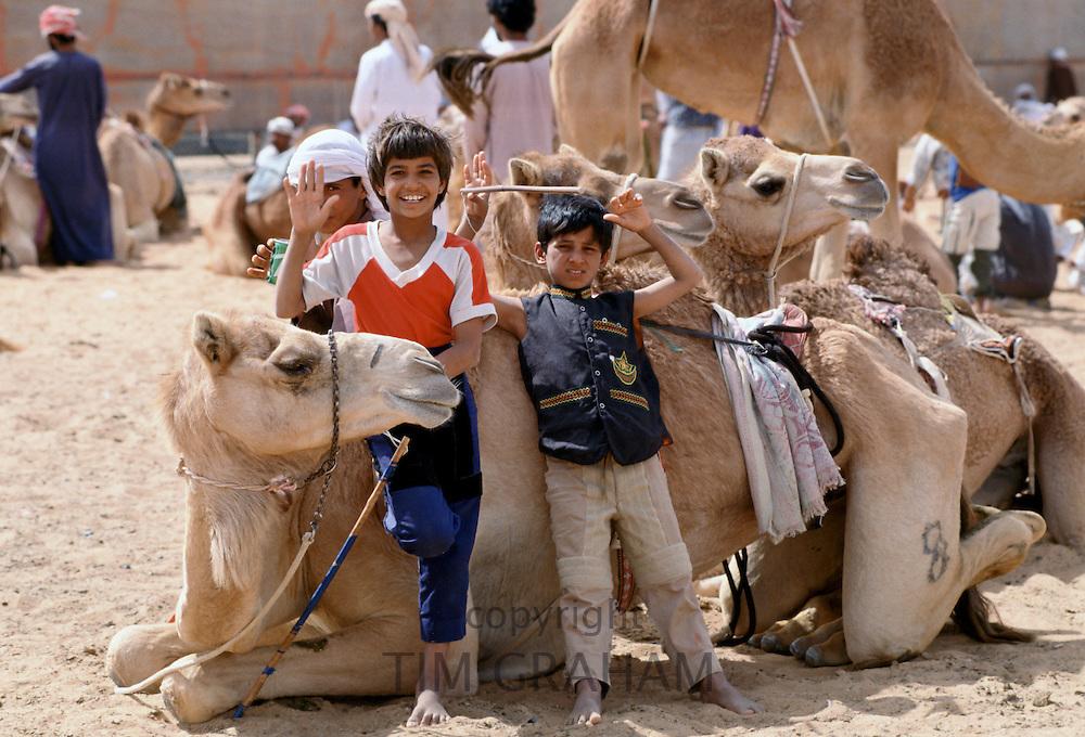 Camel herders and children, at Al Ain Abu Dhabi, United Arab Emirates